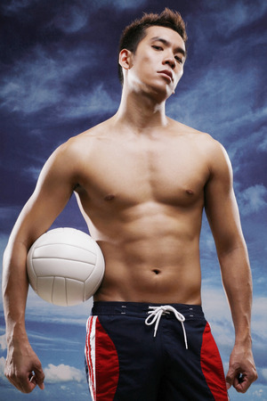 bare chested: Man posing with volleyball