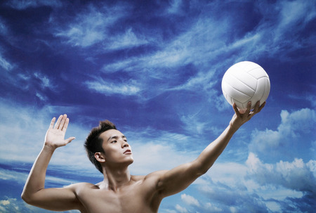 bare chested: Man playing volleyball