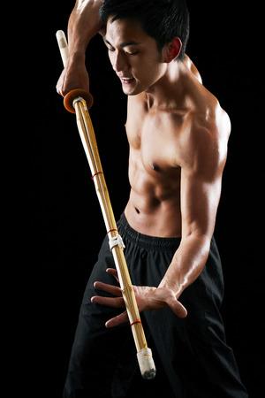 practising: Man practising the martial art of Kendo LANG_EVOIMAGES
