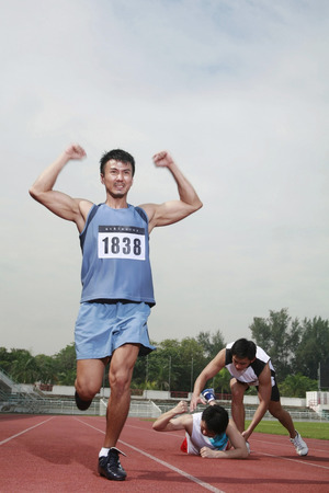 finishing line: Man upon reaching finishing line LANG_EVOIMAGES