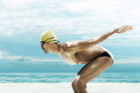 bare chested: Man ready to dive into the water LANG_EVOIMAGES