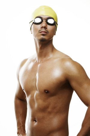 gritting: Man in swimming cap and goggles LANG_EVOIMAGES