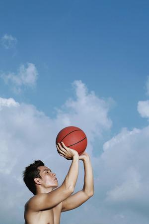 bare chested: Man playing basketball