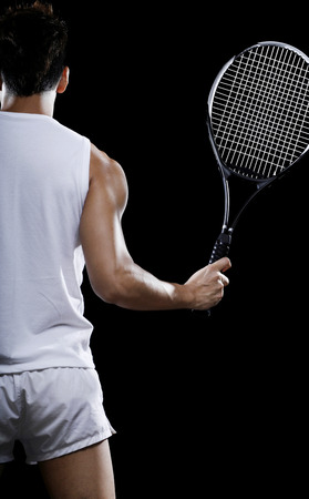 bare chested: Man with a tennis racquet LANG_EVOIMAGES