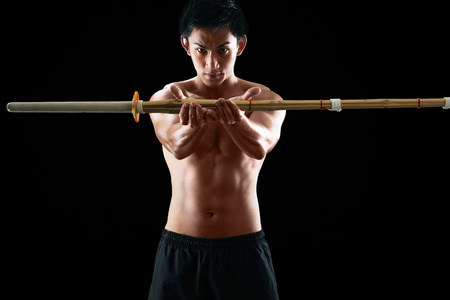 bare chested: Man practising the martial art of Kendo LANG_EVOIMAGES