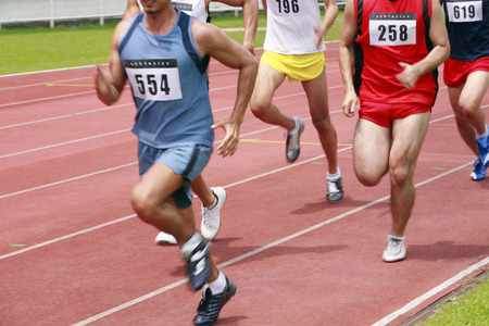 bare chested: Men in track event