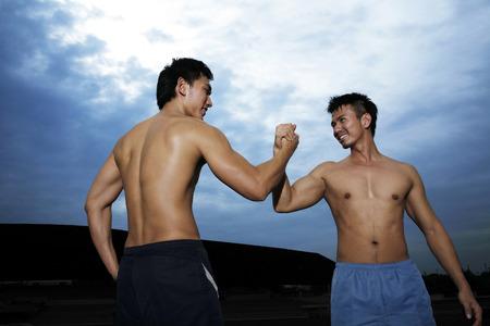 combative sport: Men celebrating their success