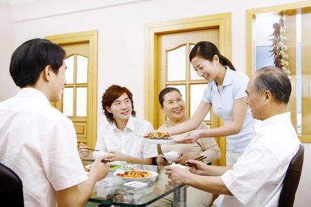 jubilating: Family having lunch together LANG_EVOIMAGES