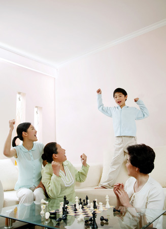 jubilating: Women and boy jubilating after winning LANG_EVOIMAGES
