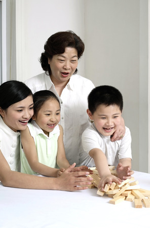 wooden block: Family playing wooden block game LANG_EVOIMAGES
