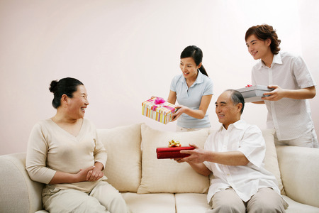 ones: Senior woman receiving present from her loved ones