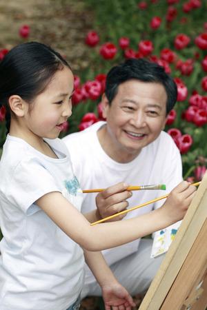hombre pintando: Pintura del hombre mayor con la muchacha LANG_EVOIMAGES