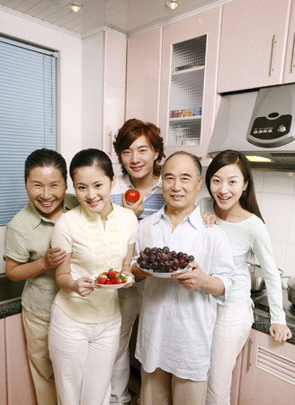 money matters: Happy family posing in the kitchen