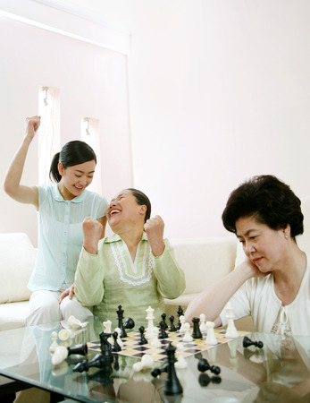 jubilating: Two women jubilating after winning, another woman looking sad LANG_EVOIMAGES