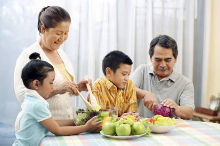 jubilating: Family preparing a meal together