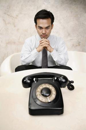 businessman waiting call: Businessman waiting for a phone call