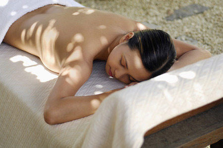 lying forward: Woman lying forward on lounge chair