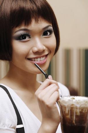 iced coffee: Woman drinking iced coffee