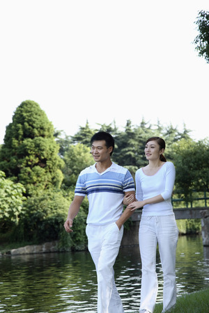 only mid adult women: Man and woman strolling in the park