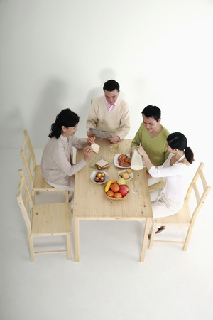 four person only: Family having breakfast together