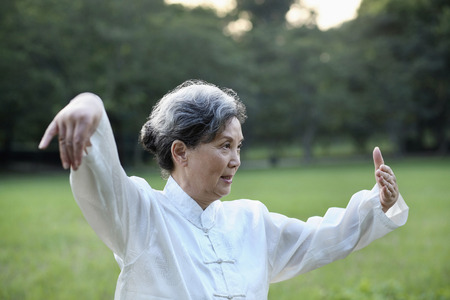 Woman practising Tai Chi in the park