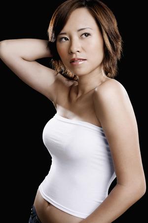 tube top: Woman in white tube top posing