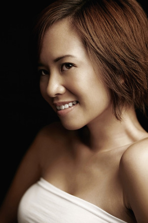 tube top: Woman in white tube top smiling