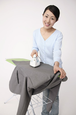 Woman ironing suit