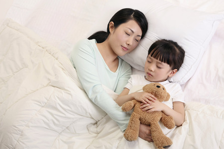 soft toy: Woman and girl sleeping, girl hugging soft toy