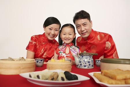 new age: Happy family in Chinese traditional clothing smiling LANG_EVOIMAGES