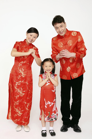 Family in chinese traditional clothing wishing Happy Chinese New Year