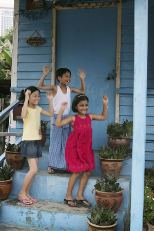 jubilating: Children jumping and cheering LANG_EVOIMAGES