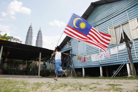 elementary age boys: Boy running with Malaysian flag