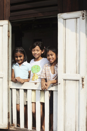 malay village: Children standing by the window