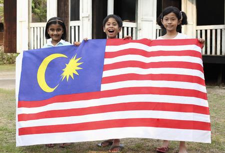 merdeka: Children holding national flag