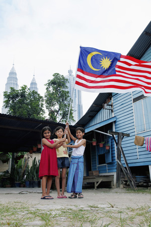 Children holding Malaysian flag