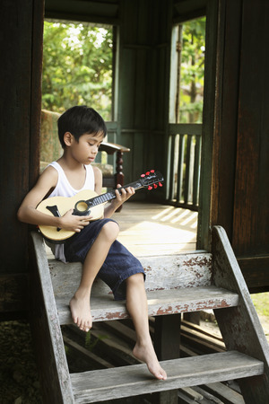 boy playing guitar: Boy playing guitar