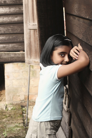 seek: Girl playing hide and seek LANG_EVOIMAGES