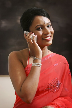 traditional clothing: Woman in traditional clothing talking on the phone LANG_EVOIMAGES