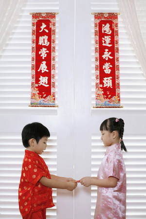 red packet: Girl passing red packet to boy