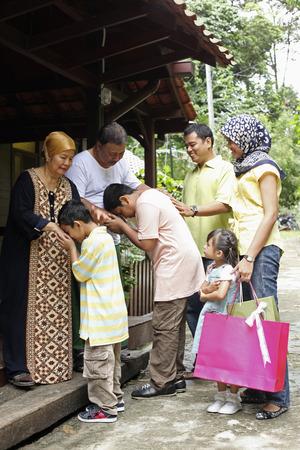 malay village: Children greeting their grandparents