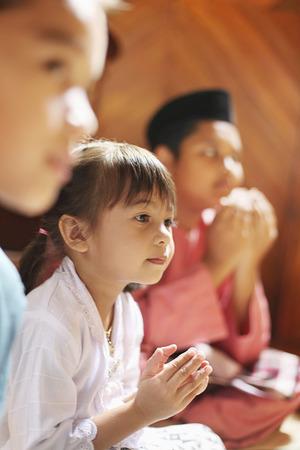 Children saying prayer Stock Photo