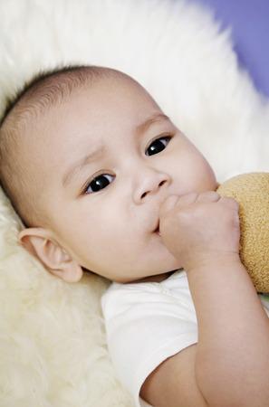 sucking: Baby sucking her thumb LANG_EVOIMAGES