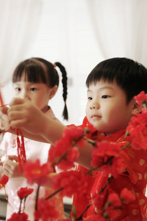 decorative item: Boy and girl decorating flowers at home