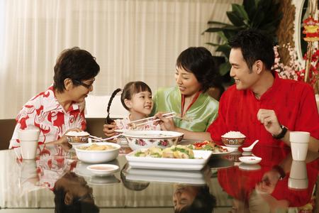 Man taking food for girl, woman and senior woman watching
