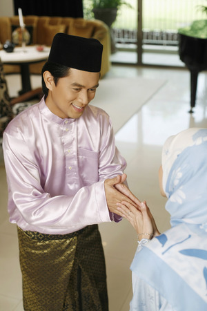 only two people: Man and woman greeting during Hari Raya