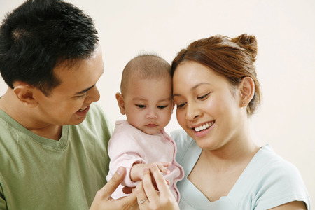 Man and woman playing with baby