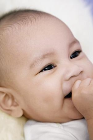 sucking: Baby sucking her finger