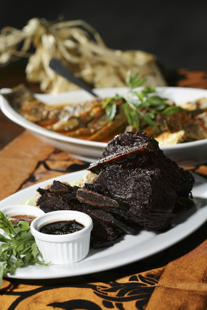 sambal: Slices of char-grilled marinated sirloin, served with a spicy tamarind dip and sambal belacan LANG_EVOIMAGES