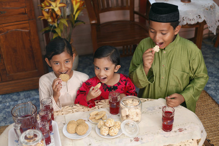 Children enjoying traditional cookies LANG_EVOIMAGES